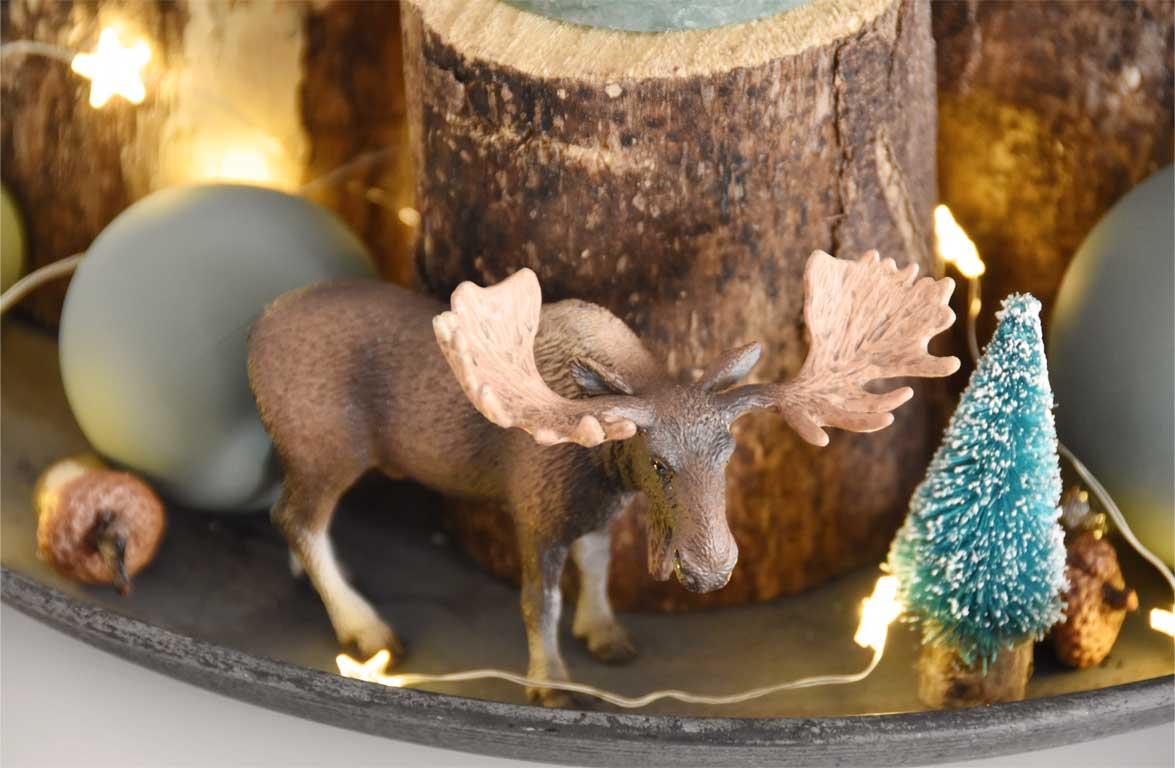 Adventskranz aus Holzstämmen